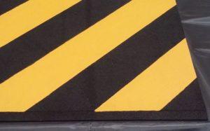 "Custom Rubber Threshold ""Hazardous"" Ramp by Australian Ramp and Access Solutions"